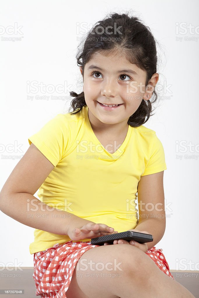 Little girl holding cell phone royalty-free stock photo