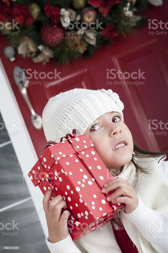 Little girl holding christmas present royalty-free stock photo