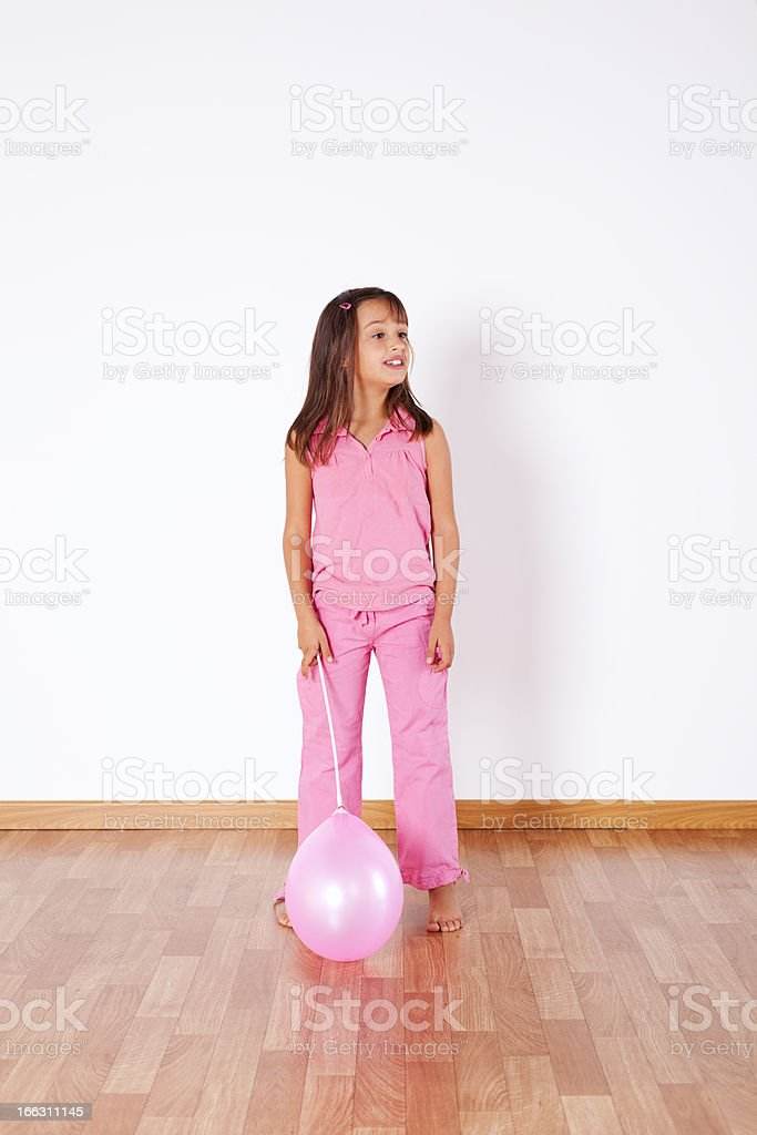 Little girl holding color ballons royalty-free stock photo
