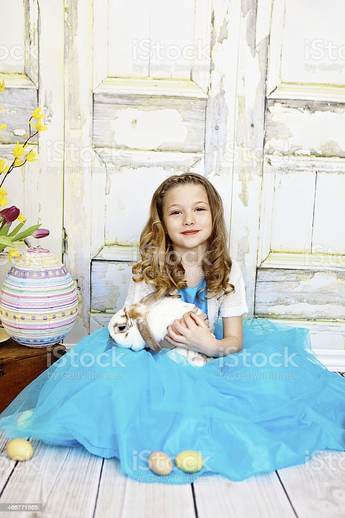 Little Girl Holding Easter Bunny stock photo