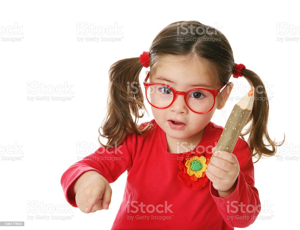 Little Girl Holding Giant Pencil royalty-free stock photo