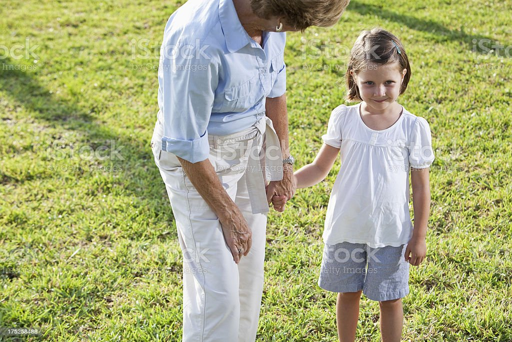 Little girl holding grandmother's hand stock photo