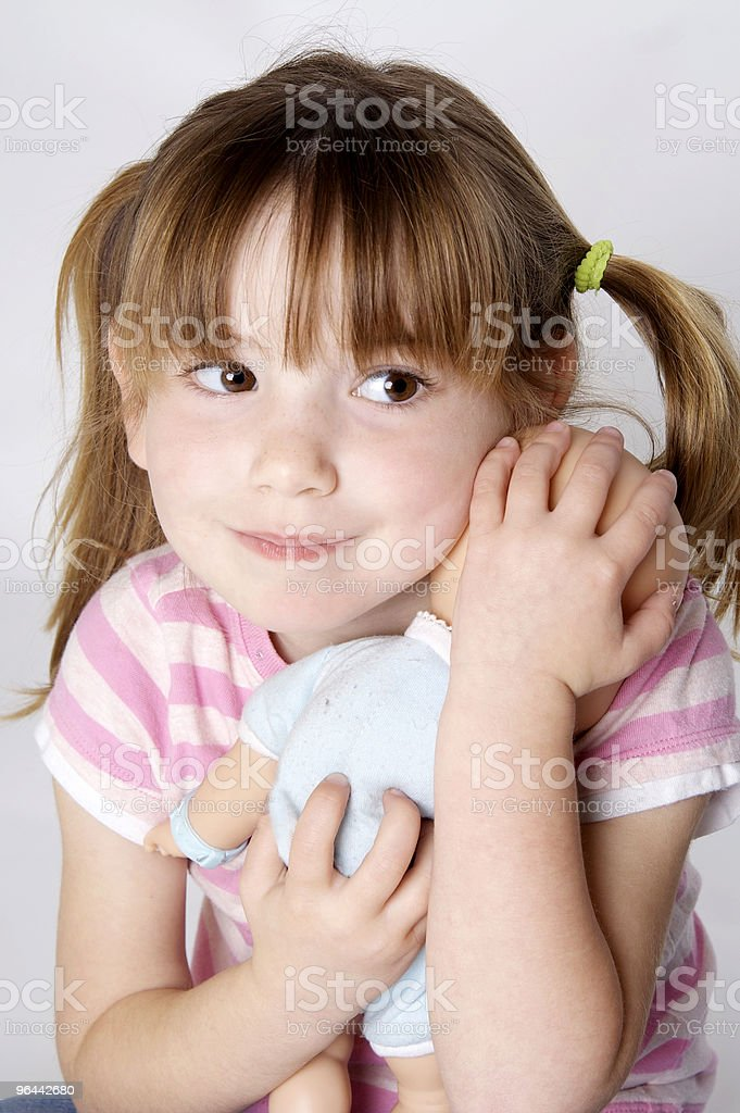 Little Girl Holding Her Baby Doll royalty-free stock photo