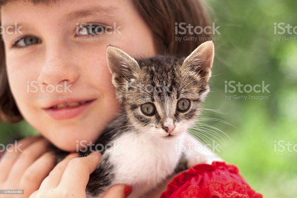 Little girl holding kitten royalty-free stock photo
