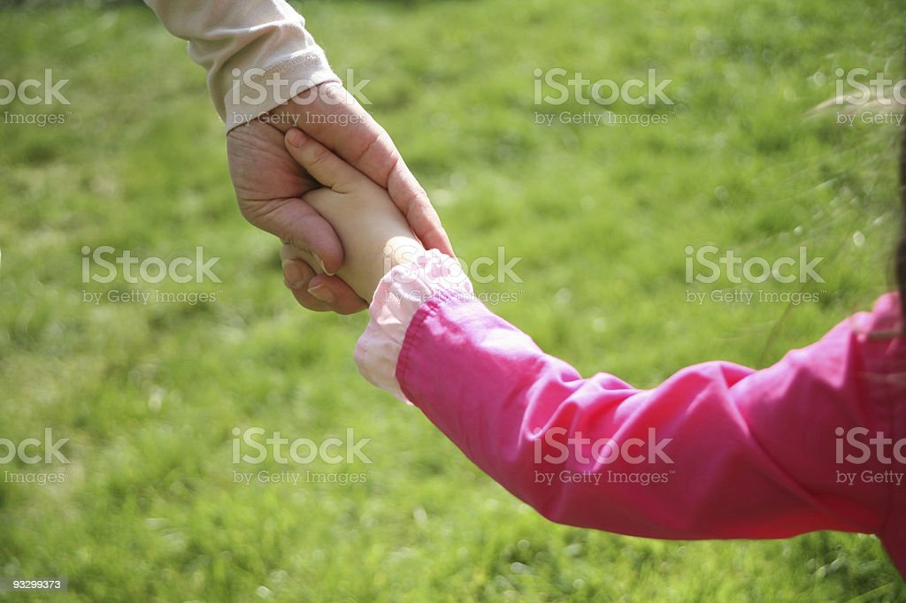 little girl holding mom's hand royalty-free stock photo