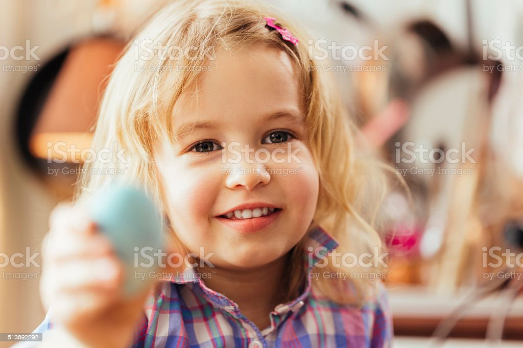 Little Girl Holding Natural Dyed Easter Egg stock photo