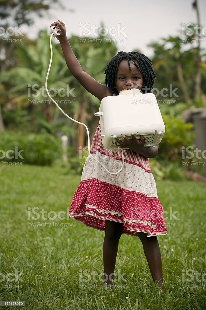 Little girl holding toaster royalty-free stock photo