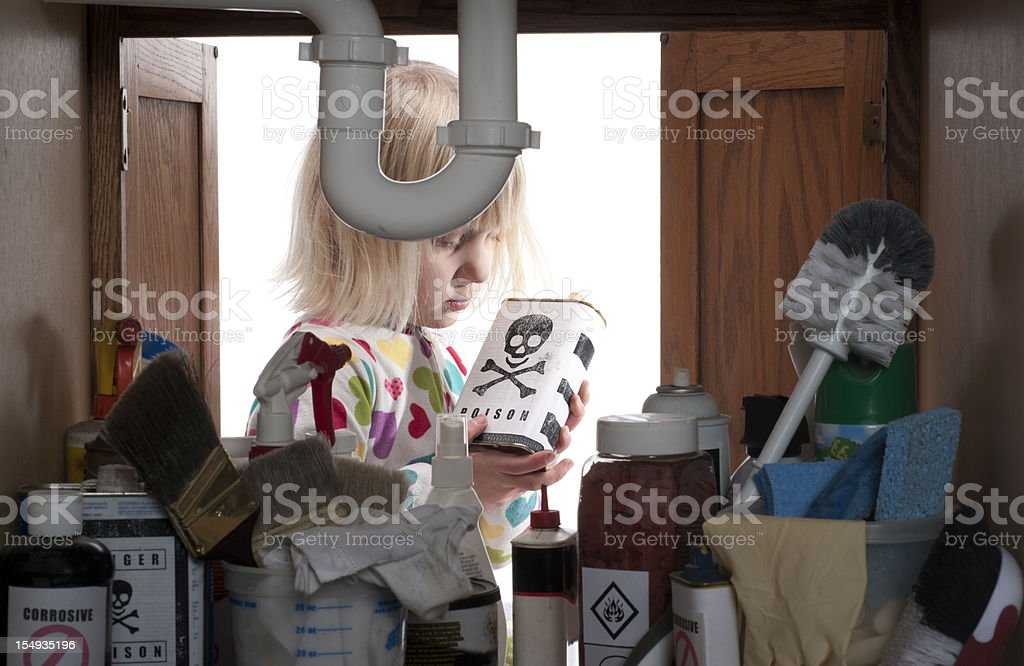CHILD SAFETY SERIES-#3 little girl holding toxic material royalty-free stock photo