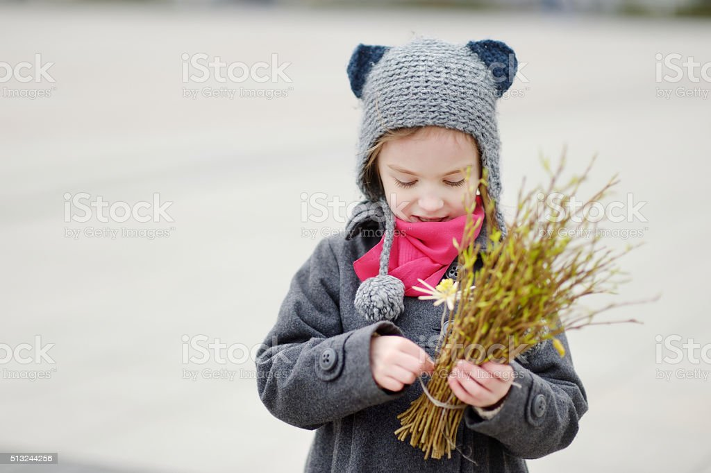 Little girl holding willow branches on Easter stock photo