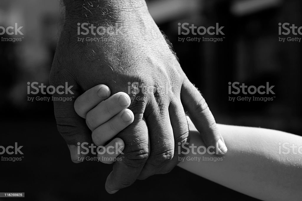 Little Girl Holds Father's Hand For Life Insurance stock photo