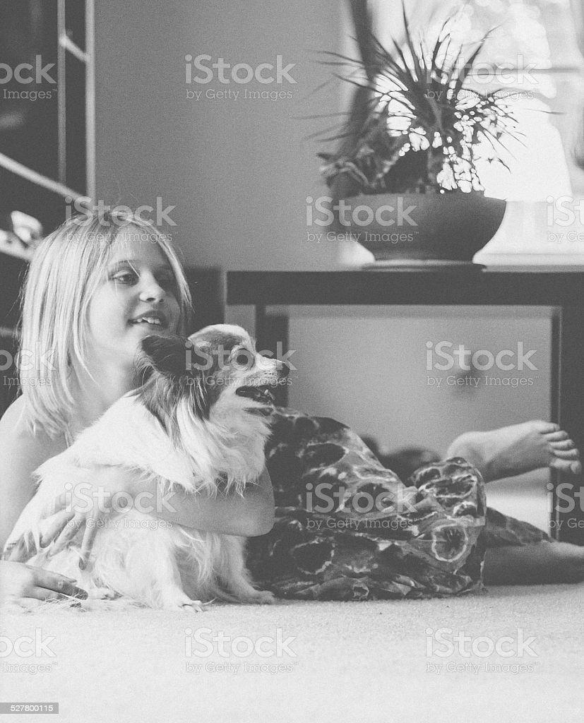 Little Girl hugging Dog stock photo