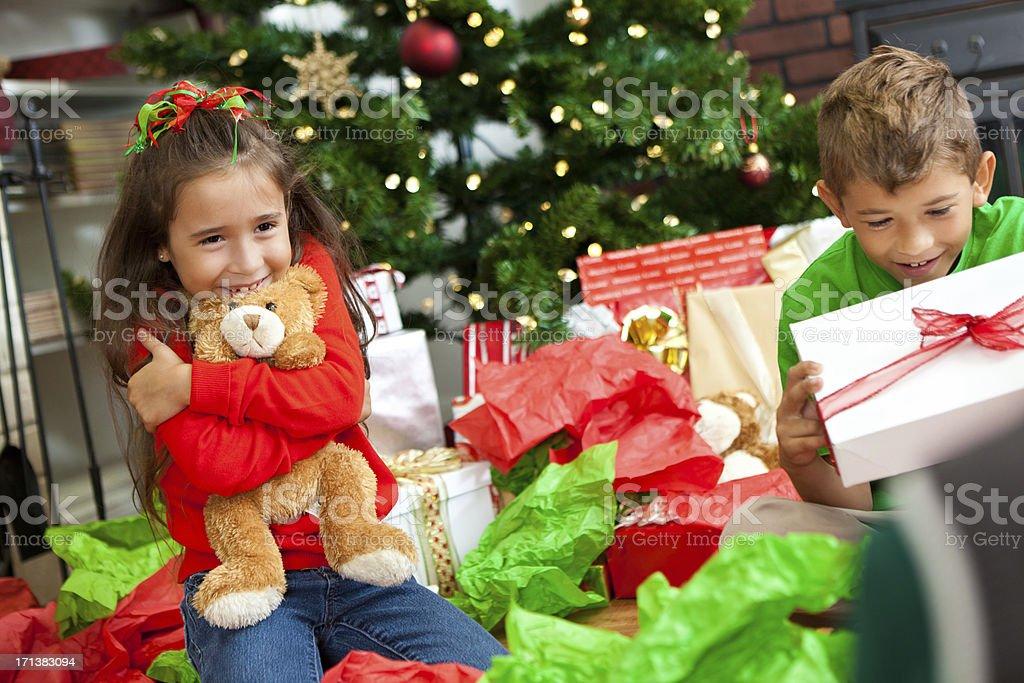 Little girl hugging her bear she got for Christmas royalty-free stock photo