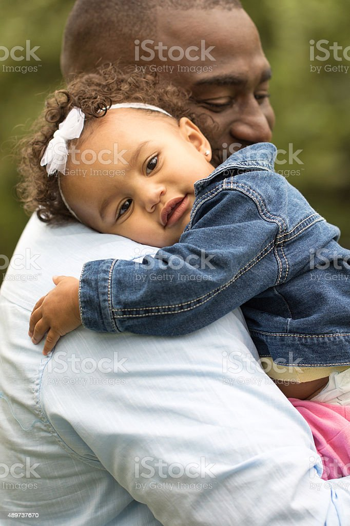 Little girl hugging her father. stock photo
