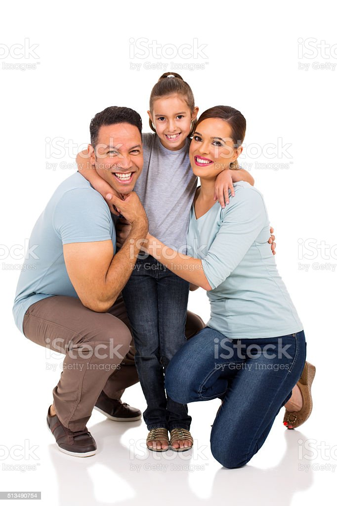 little girl hugging her parents stock photo