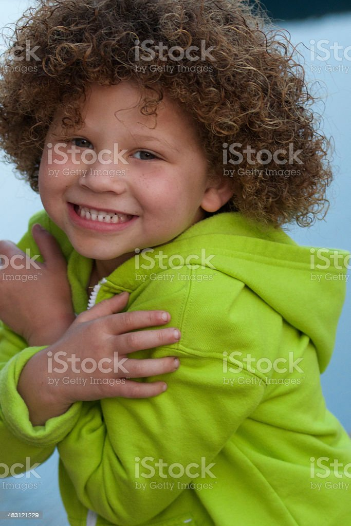 Little Girl hugging herself with big smile stock photo