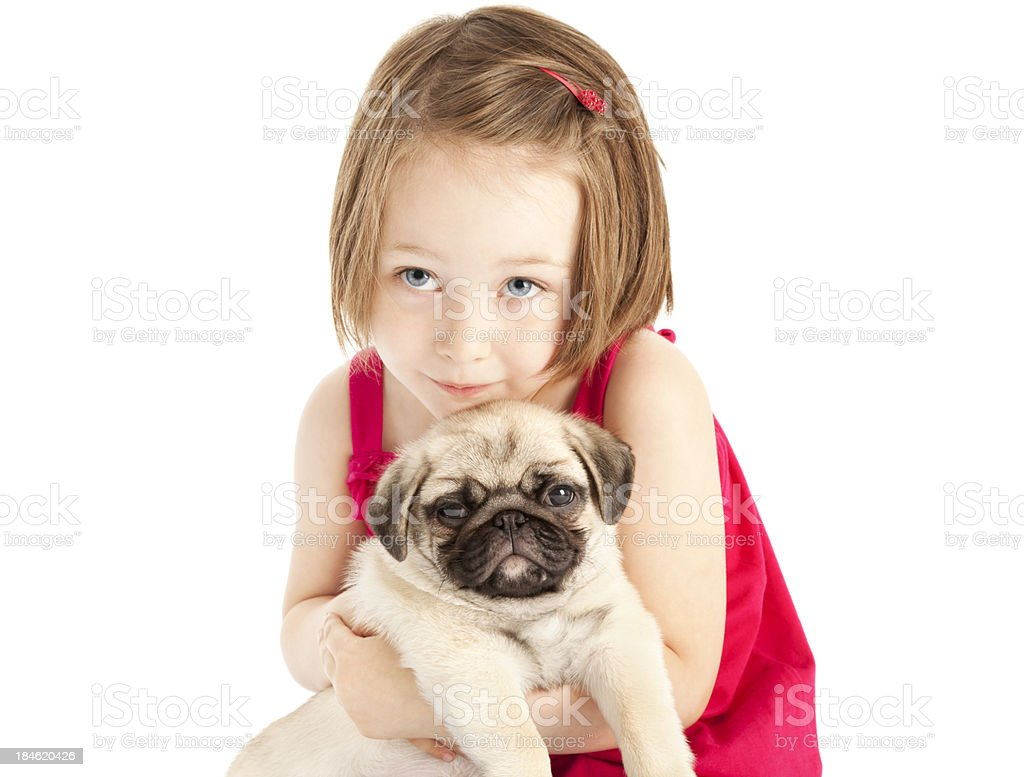 Little Girl Hugging Pug Puppy royalty-free stock photo