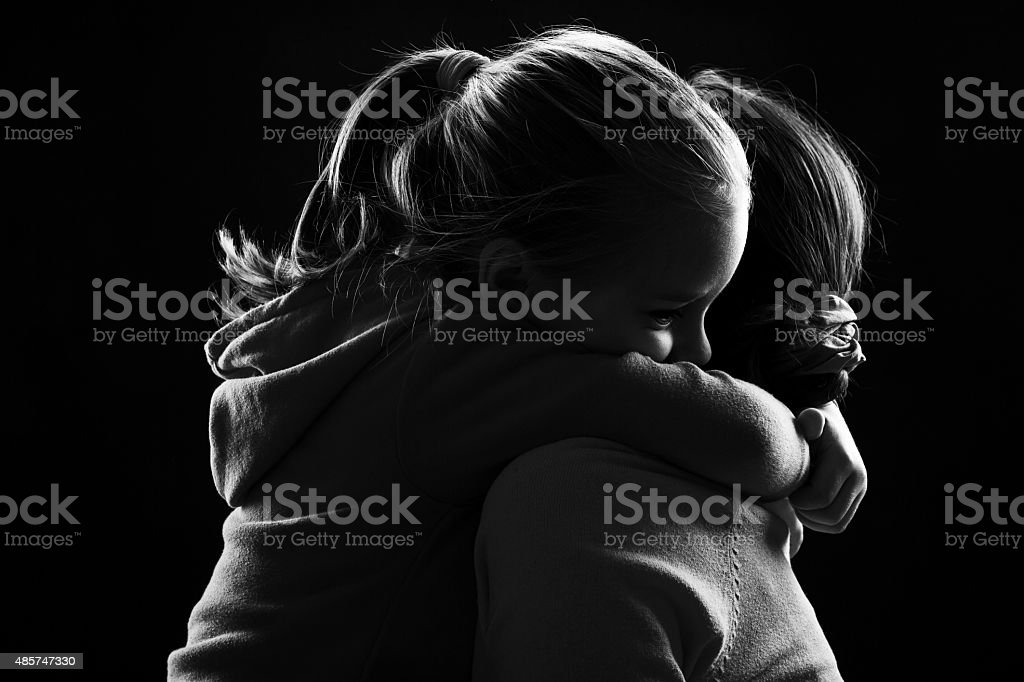 Little girl hugs her mother stock photo
