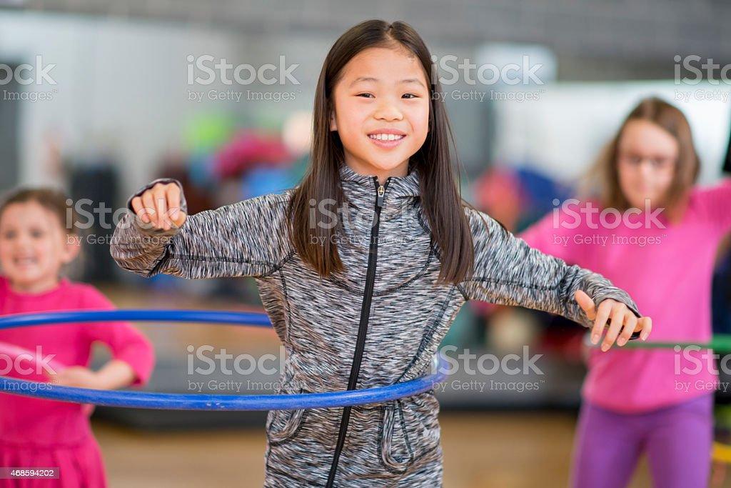 Little Girl Hula Hoop stock photo