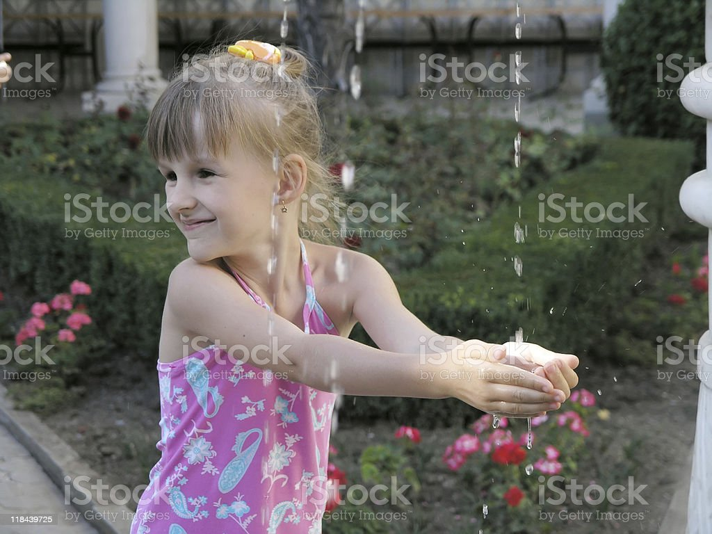 little girl hungry for water stock photo