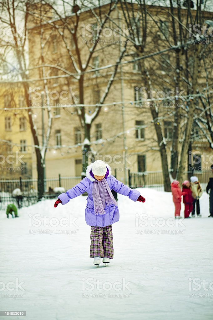 Little girl ice-skating stock photo