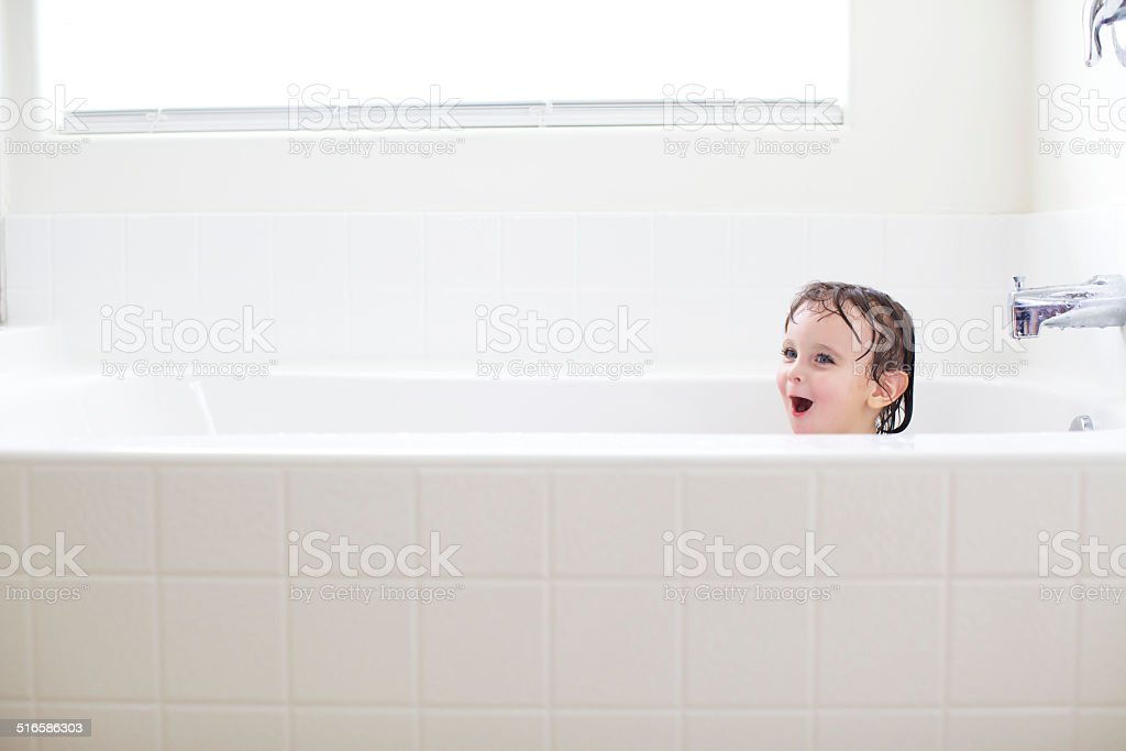 Little Girl In A BathTub stock photo
