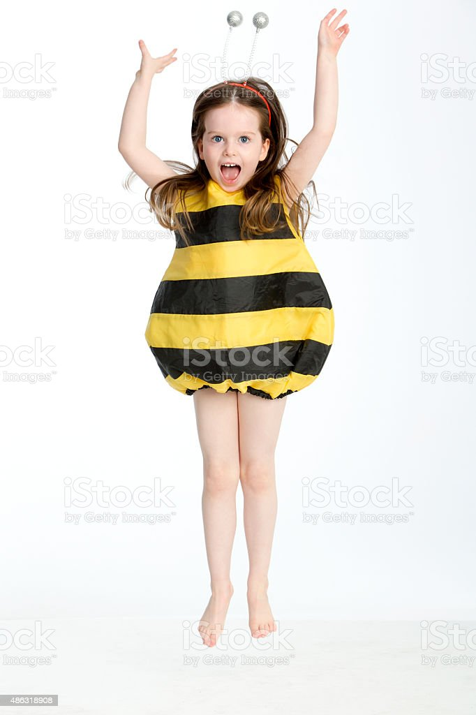 Little Girl in a Bumble Bee Costume stock photo