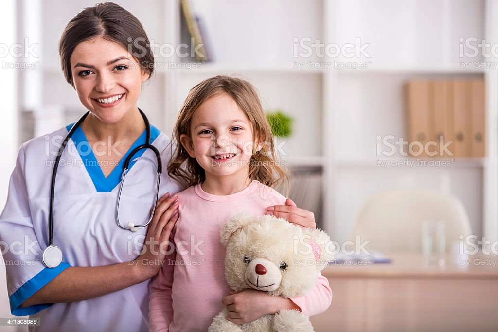 Little girl in a doctor stock photo