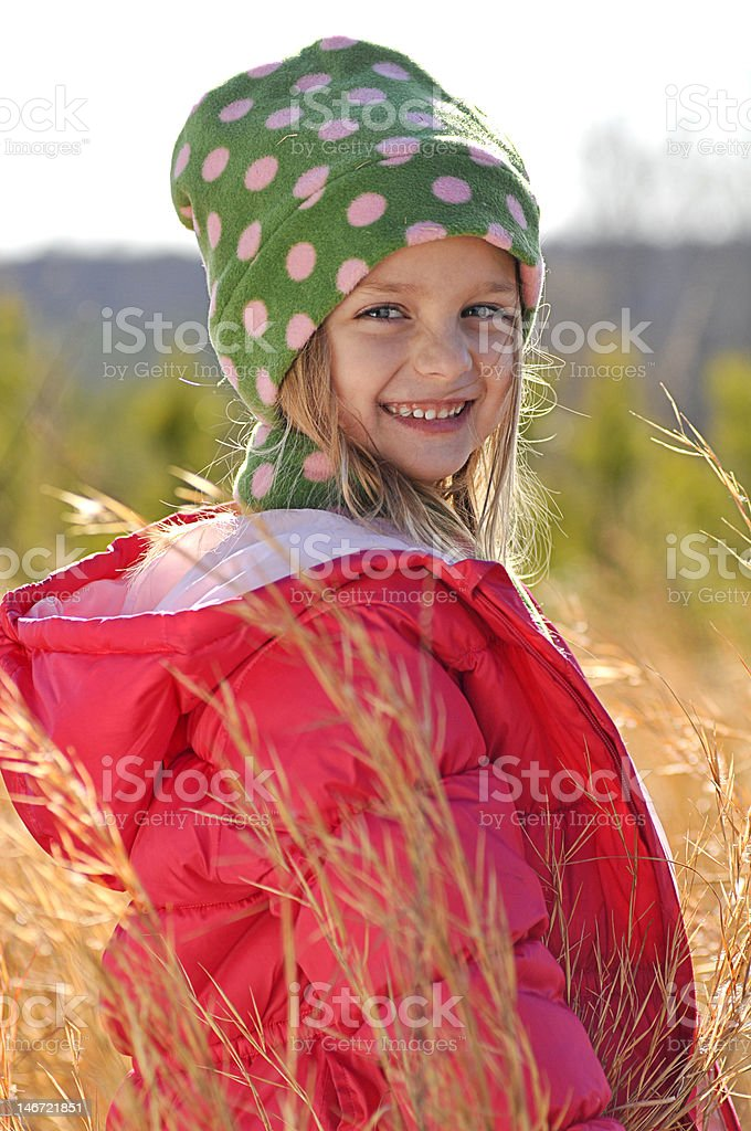 Little girl in a field royalty-free stock photo