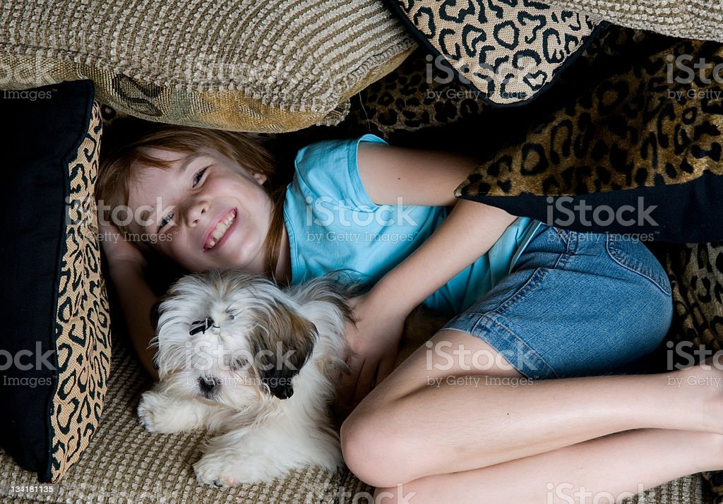 Little Girl in a Fort with her Puppy royalty-free stock photo
