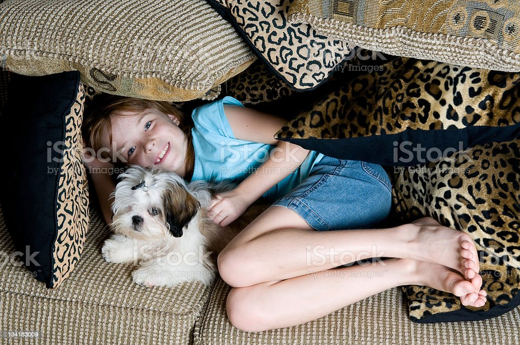 Little Girl in a Fort with her Puppy stock photo