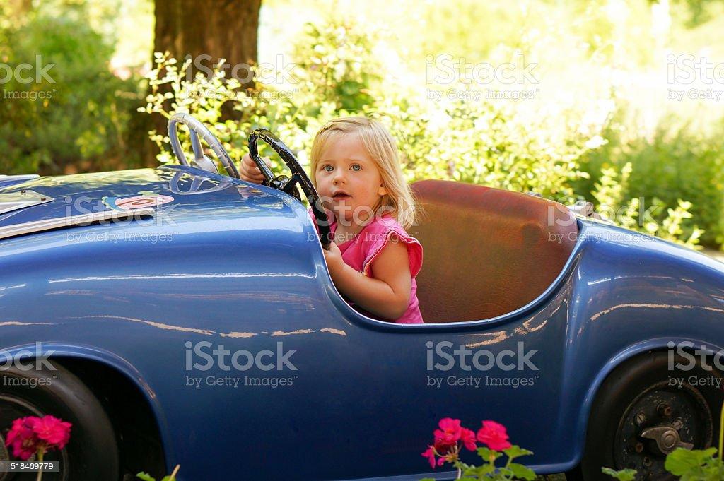 little girl in a fun fair drive car stock photo