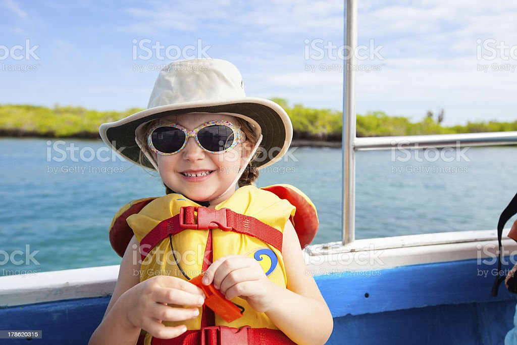 Little girl in a life jacket stock photo
