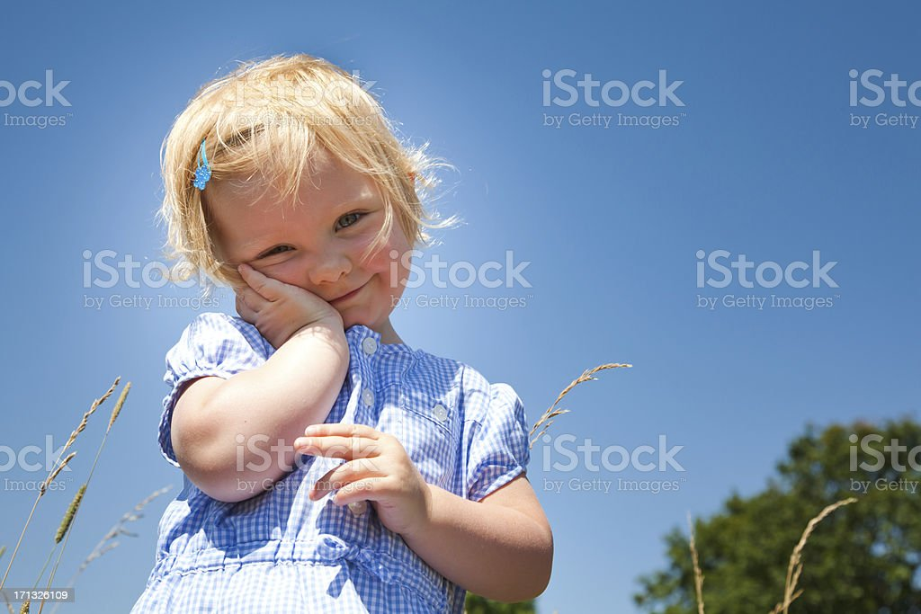 Little girl in a park stock photo