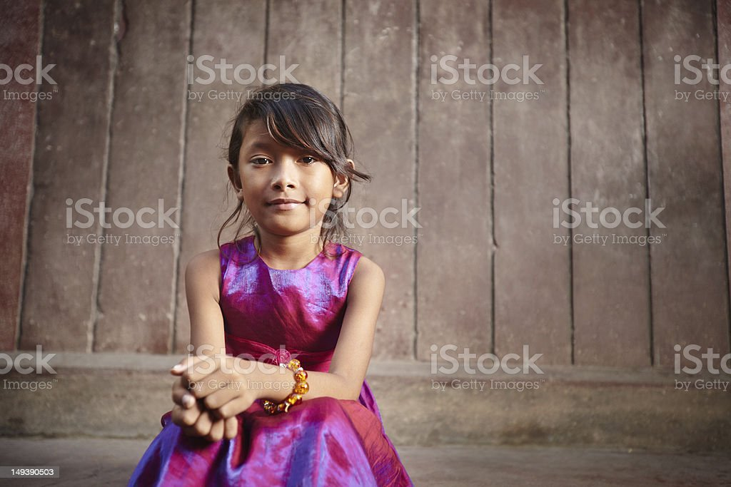 Little girl in a pink party dress posing outside for a photo stock photo