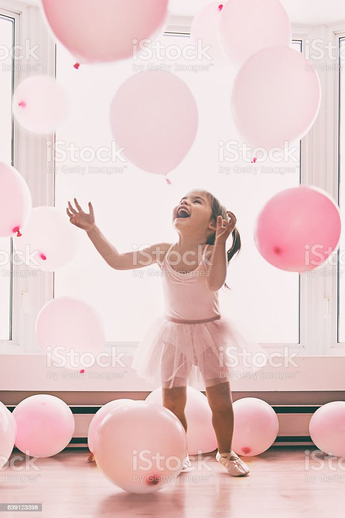 Little girl in a pink world stock photo