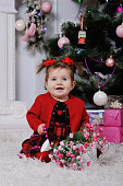 little girl in a red dress on  background of the