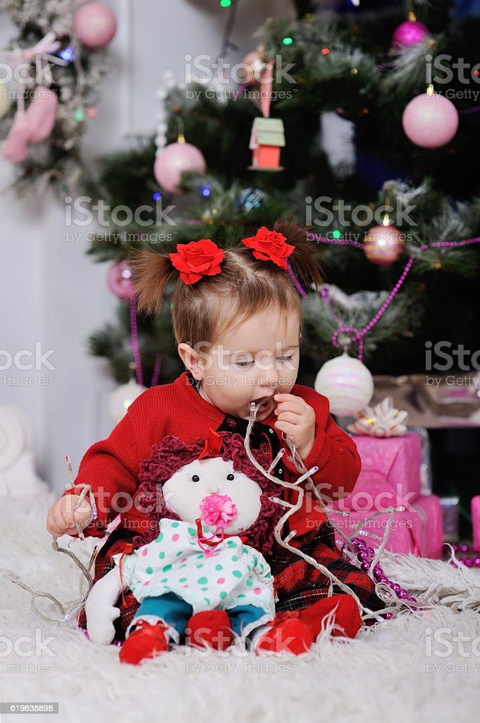 little girl in a red dress on  background of the stock photo