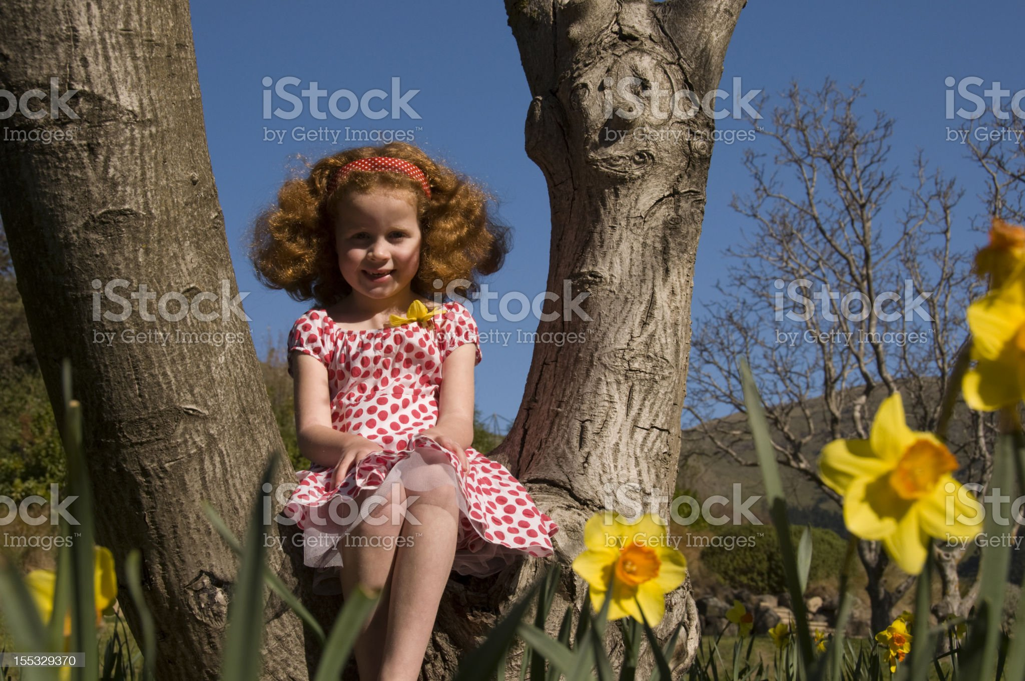 Little girl in a springtime garden royalty-free stock photo