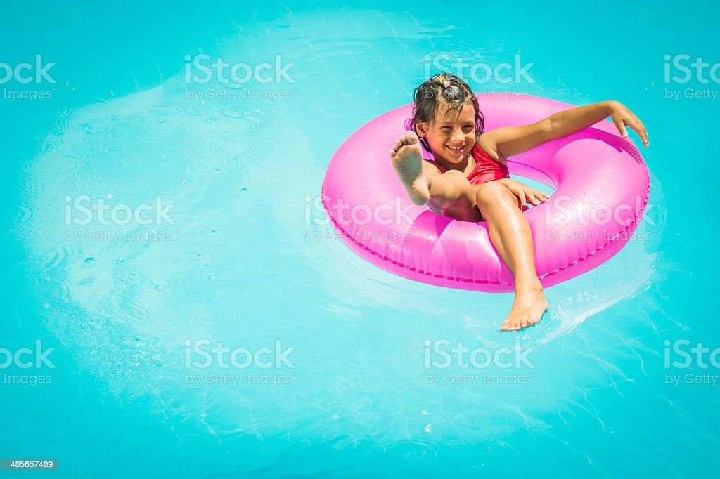 Little girl in a swimming pool royalty-free stock photo