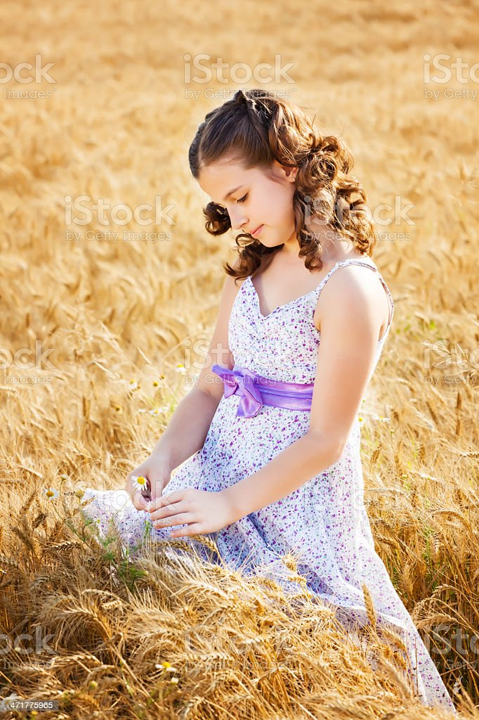 Little girl in a wheat field royalty-free stock photo