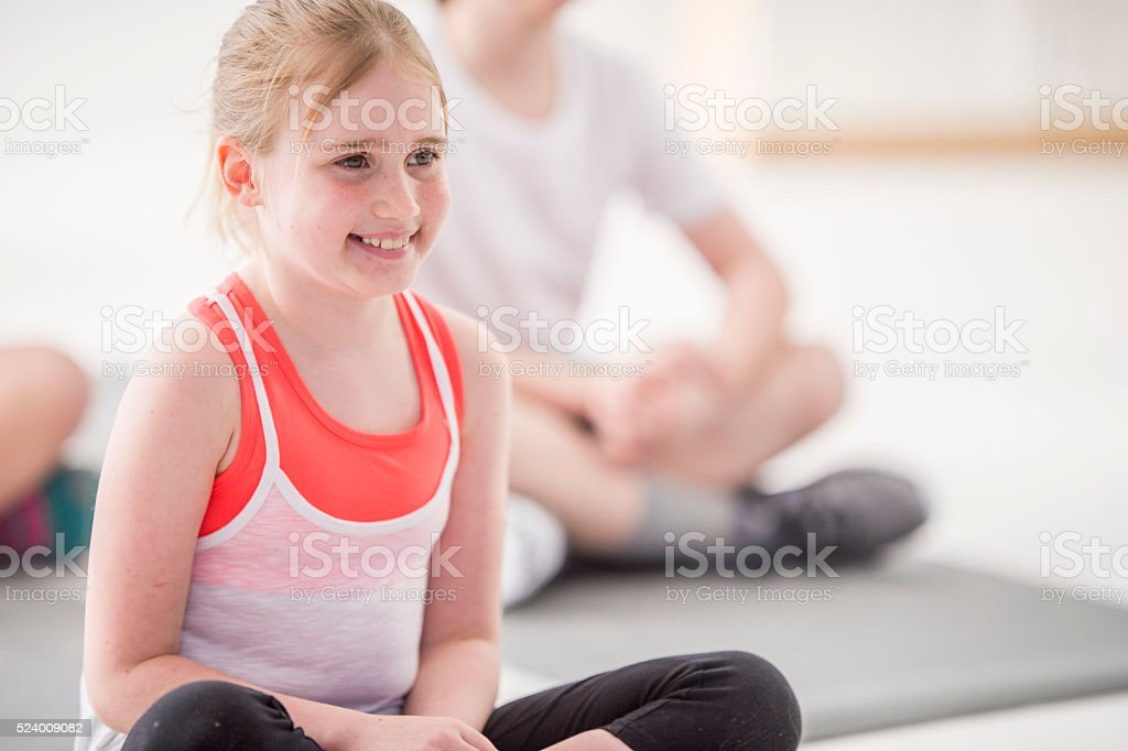 Little Girl in a Yoga Class stock photo