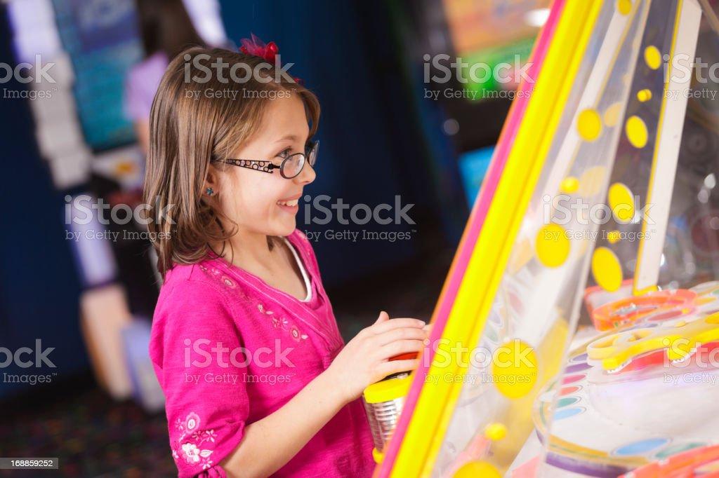 Little Girl in an Amusement Arcade stock photo