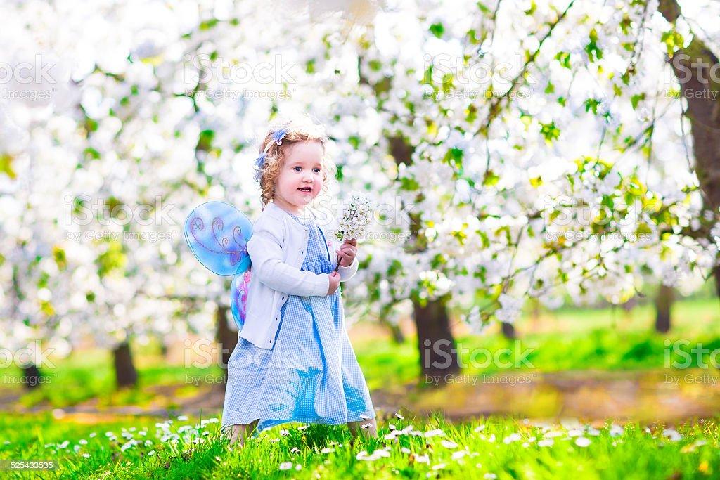 Little girl in apple garden stock photo