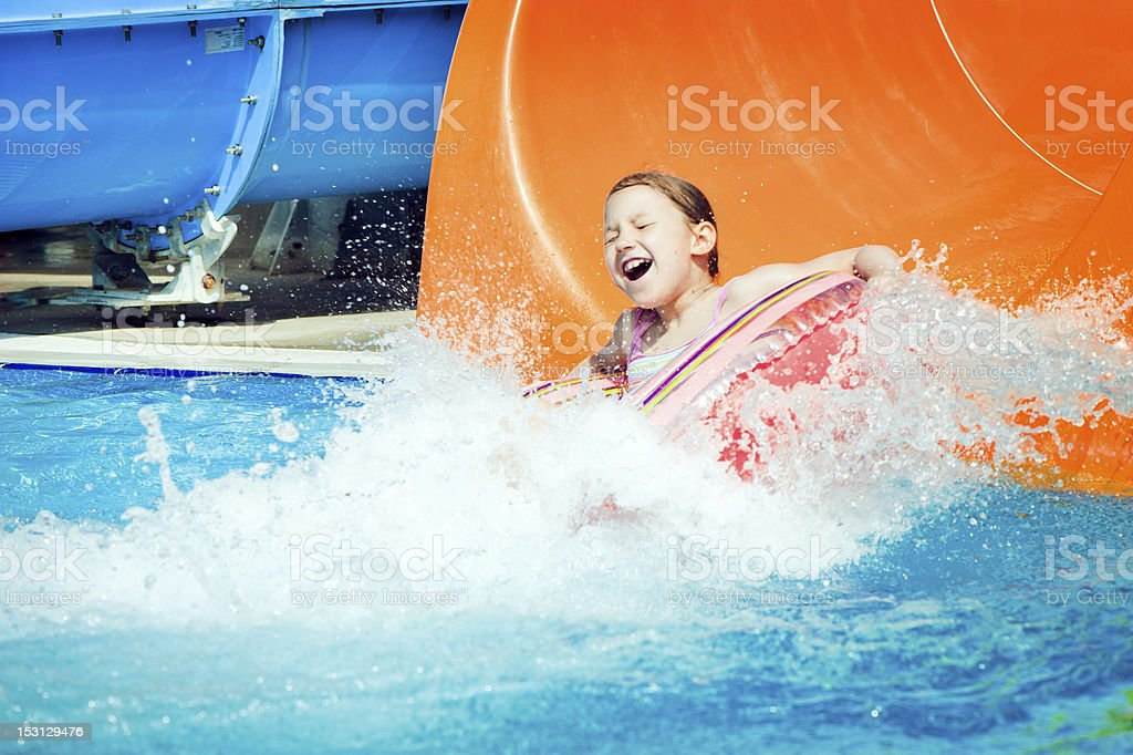 Little girl in aquapark stock photo