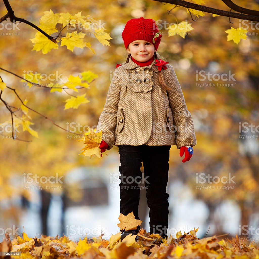 Little girl in autumn park royalty-free stock photo