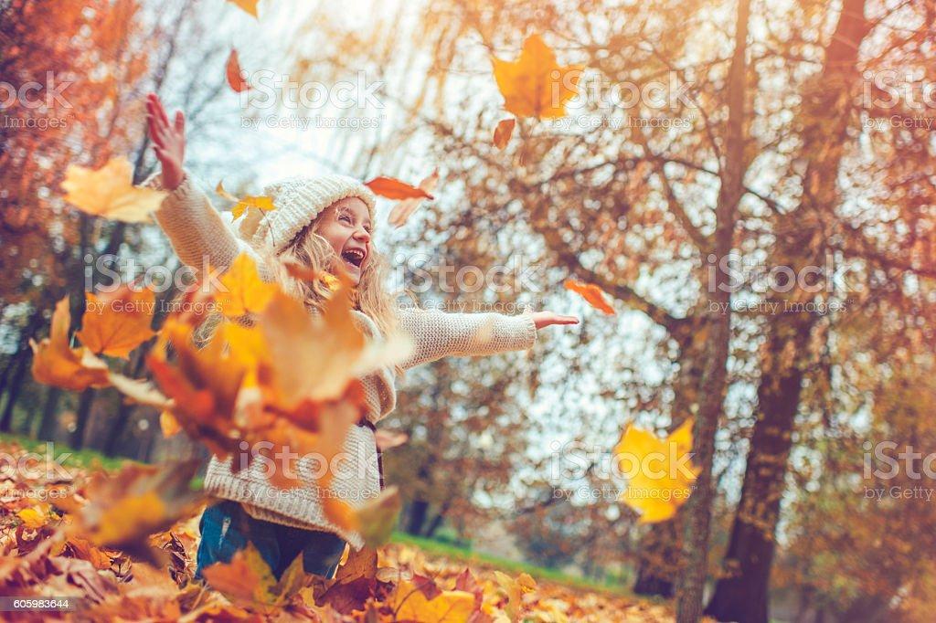 Little girl in autumn park stock photo