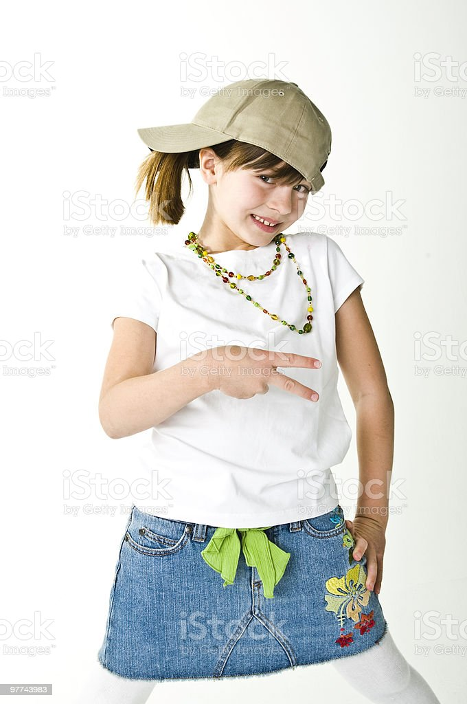 Little girl in ball cap striking a pose stock photo