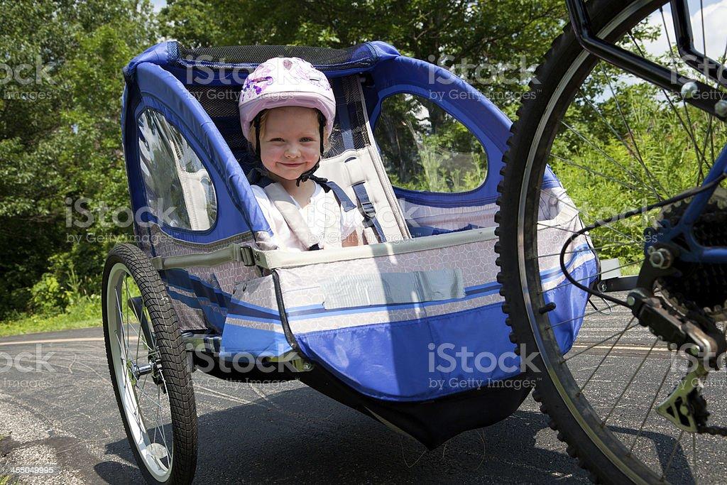 Little girl in bike trailer royalty-free stock photo