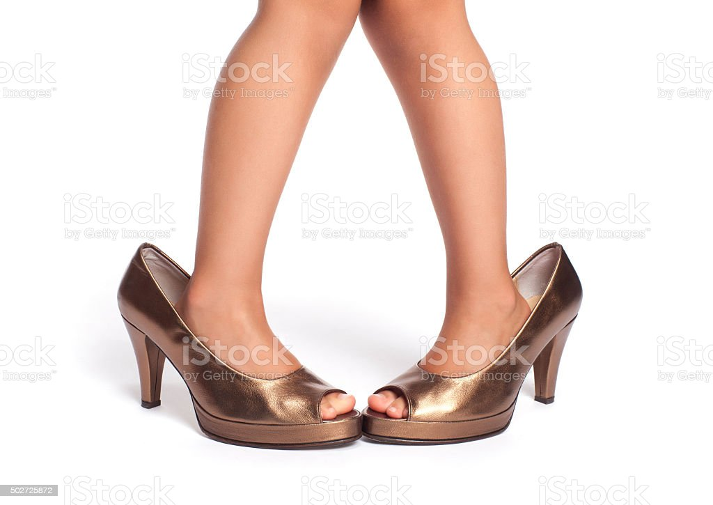 Little girl in bronze shoes isolated on white stock photo