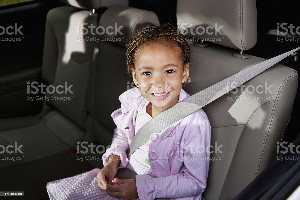 Little girl in car stock photo
